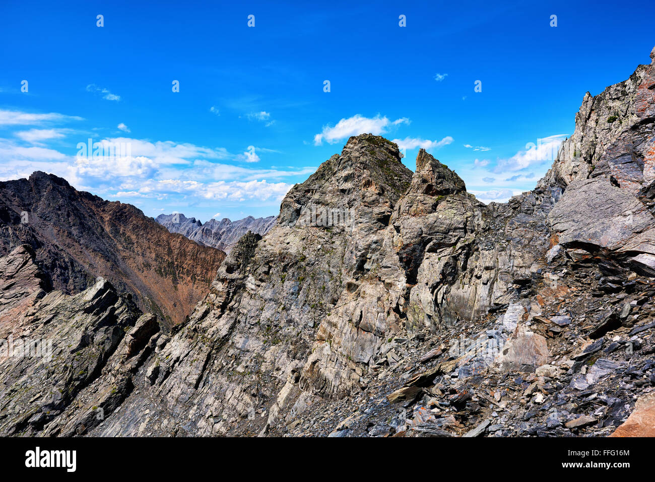 Crest of  high ridge with a steep slope . Eastern Sayan mountains . Buryatia - Stock Image