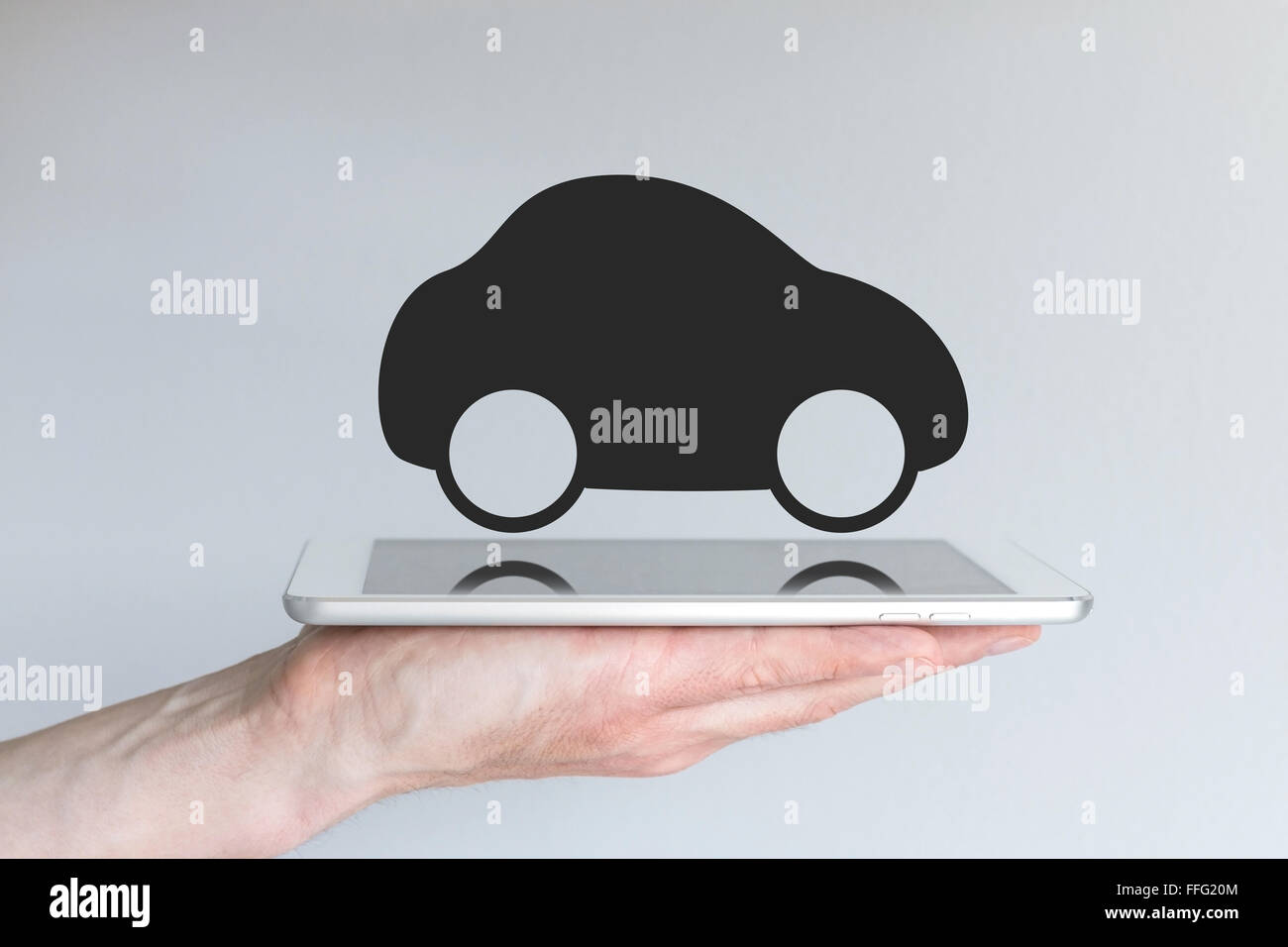 Digital mobility and mobile computing concept. Black car icon as example for disruptive transportation and taxi - Stock Image
