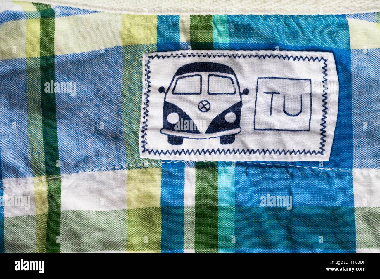 TU campervan label in toddlers shirt - Stock Image