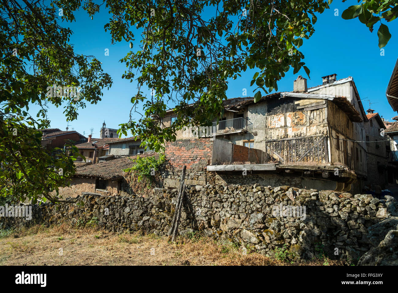 Decaying old buildings on the edge of town. La Alberca, Castille y Leon, Spain - Stock Image