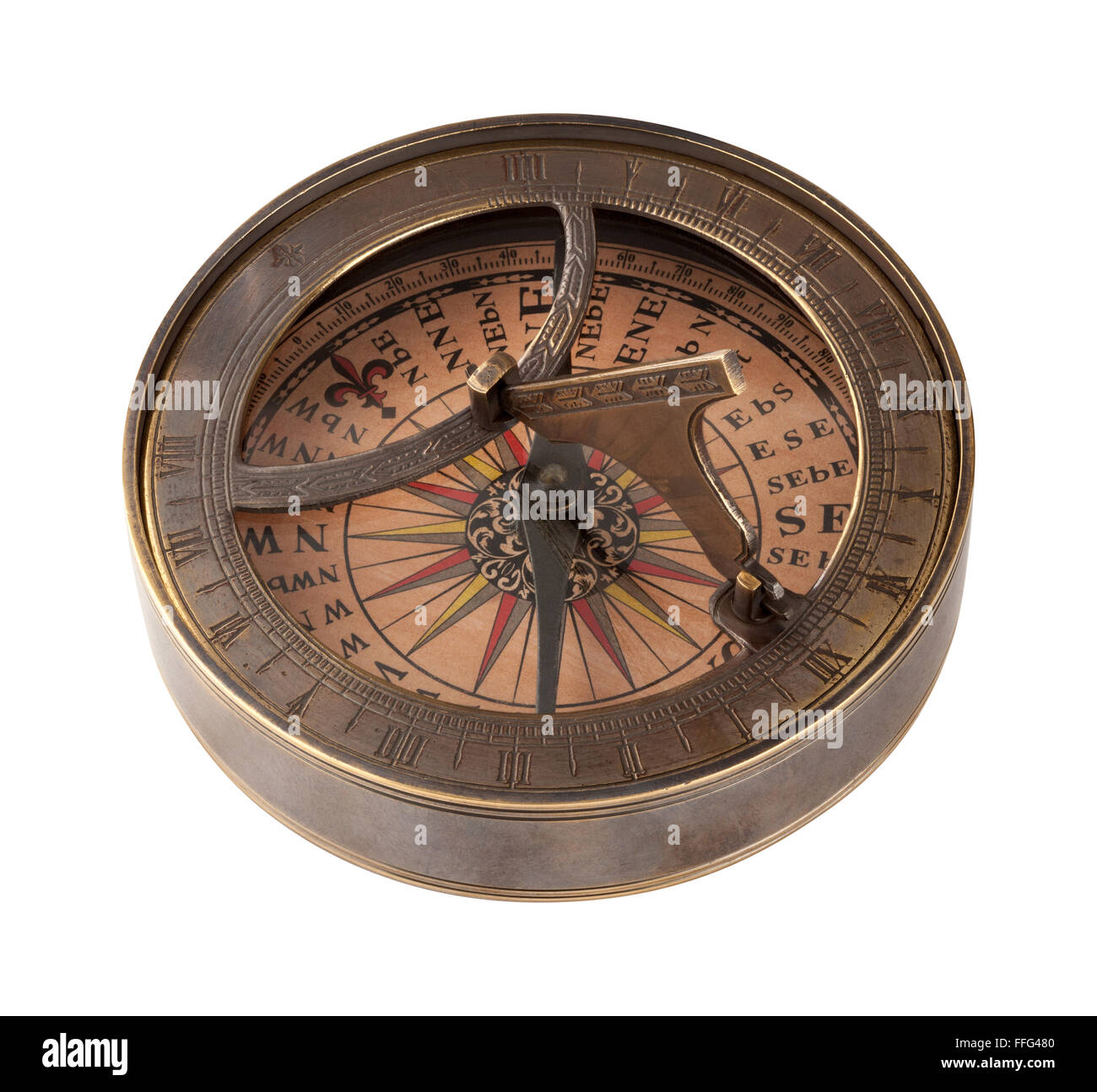 Ancient Brass Compass and Sundial. The image is a cut out, isolated on a white background, with a clipping path - Stock Image