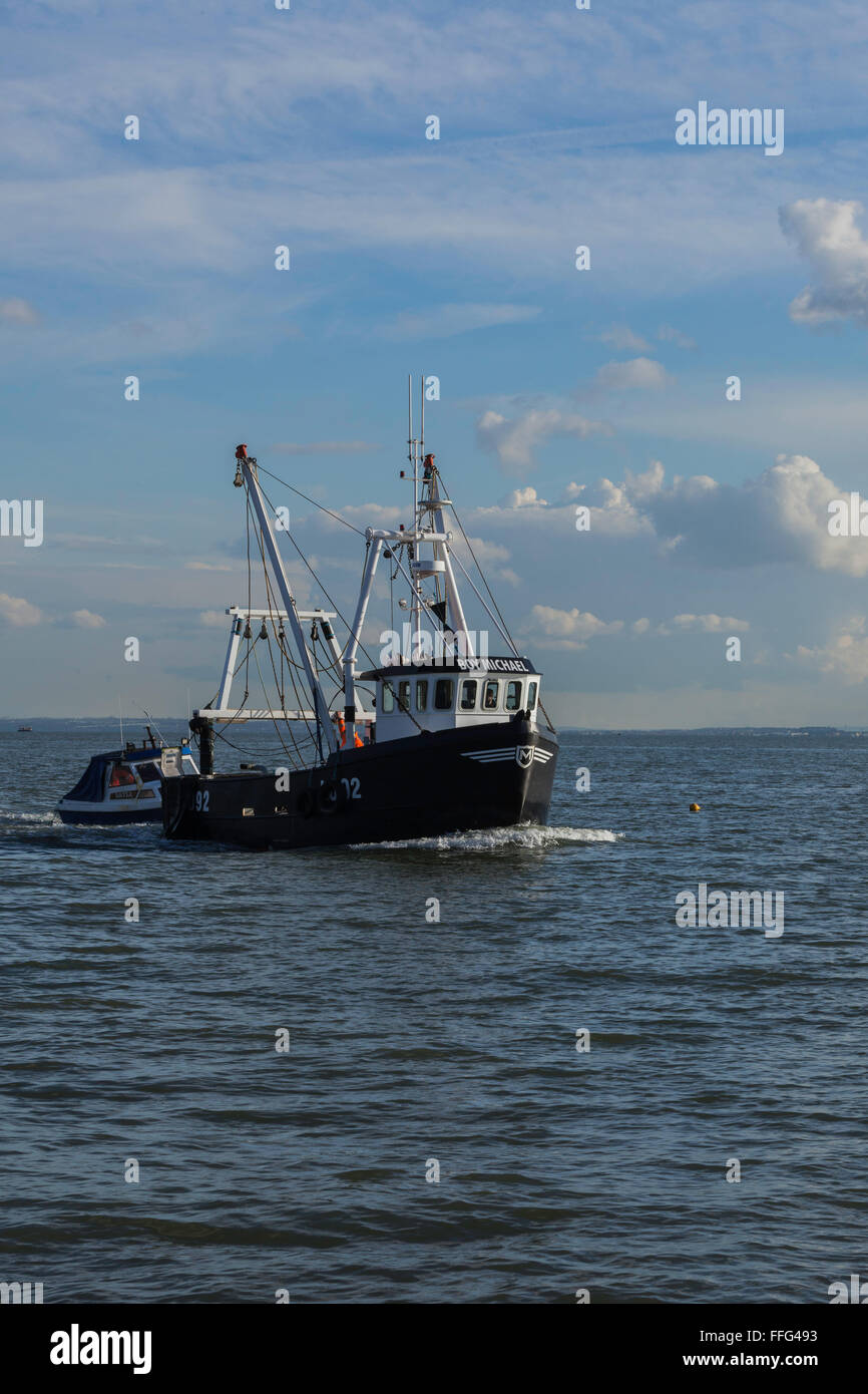 Fishing Boat Towing Smaller Craft in to Old Leigh - Stock Image