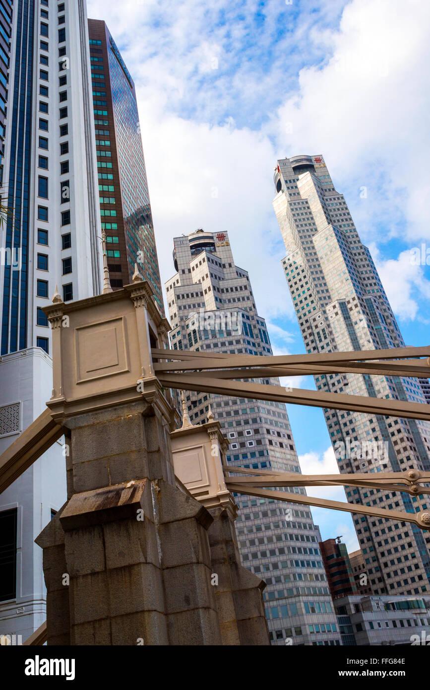 The Cavenagh Bridge detail and High Rise Buildings, Singapore - Stock Image