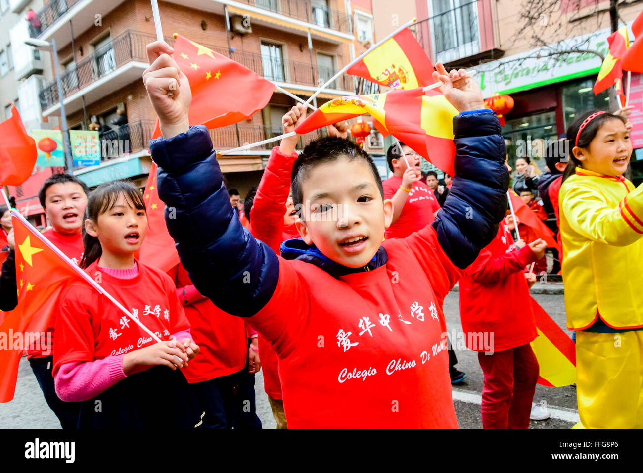 13th February 2016 Madrid, Spain. A young boy from the Chinese College in Madrid looking at the camera and waving - Stock Image