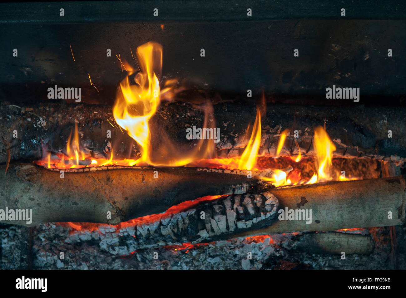 Wooden fire in old open oven England UK Europe - Stock Image
