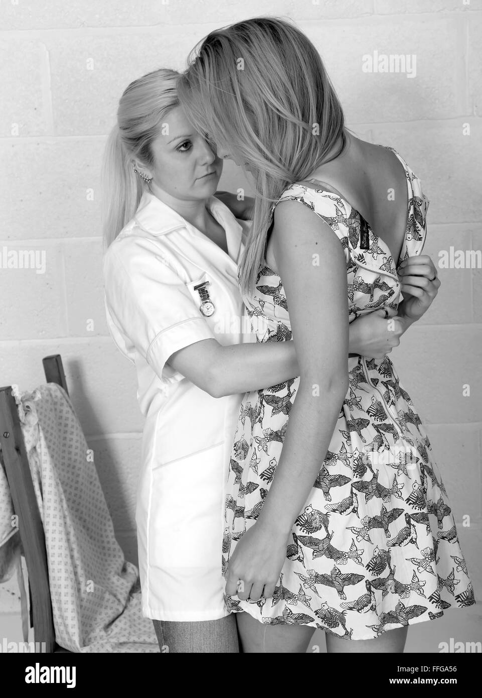 Young nurse assisting a patient undress and change into a
