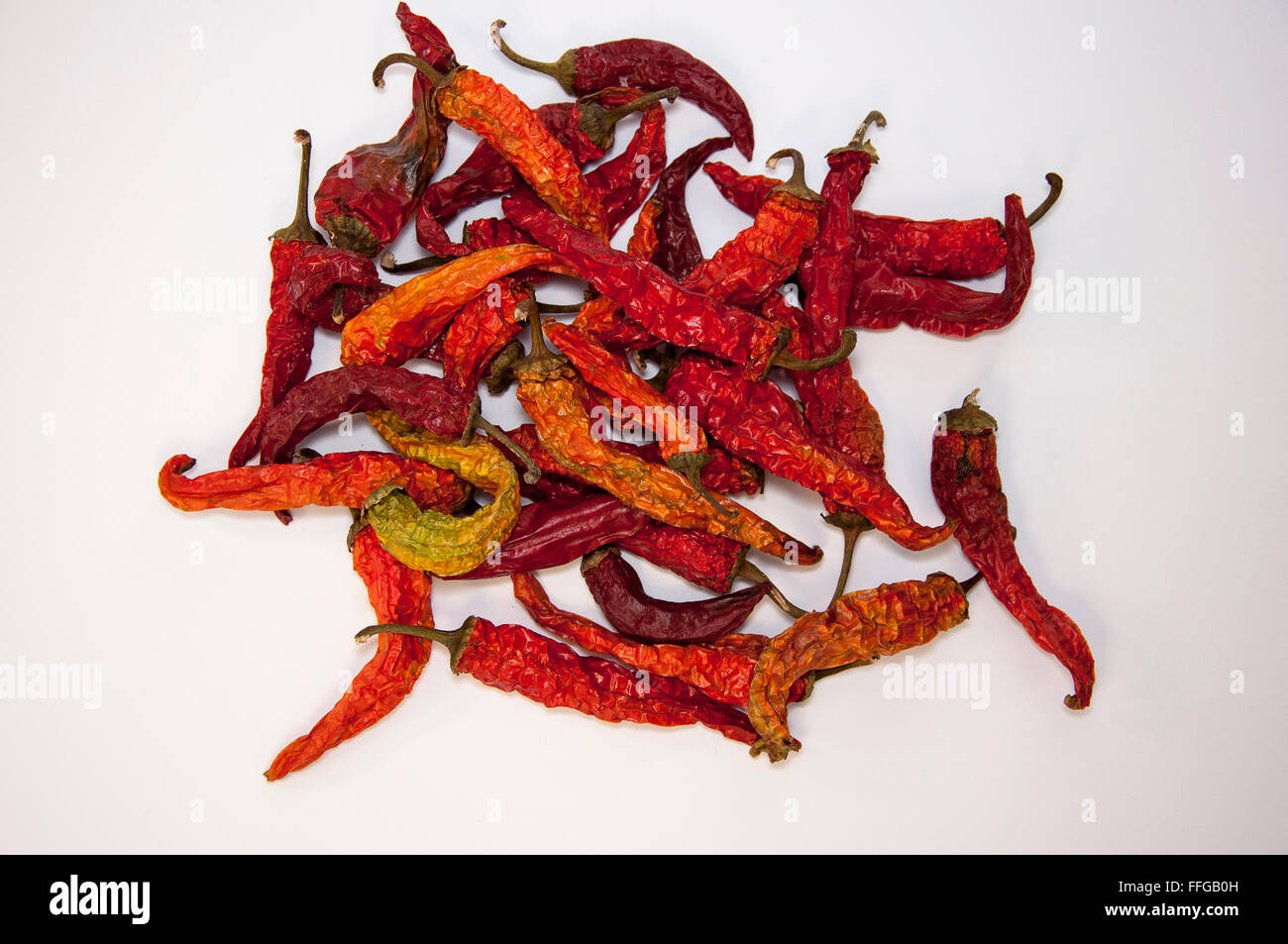 A lot of red hot dried red pepper - Stock Image