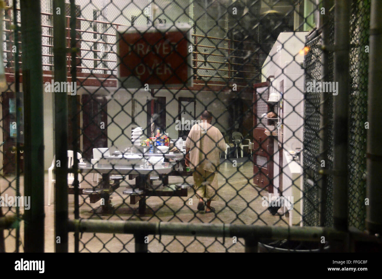 detainees guantanamo bay cuba camp six cell block muslim food prayer over sign wearing own clothes - Stock Image