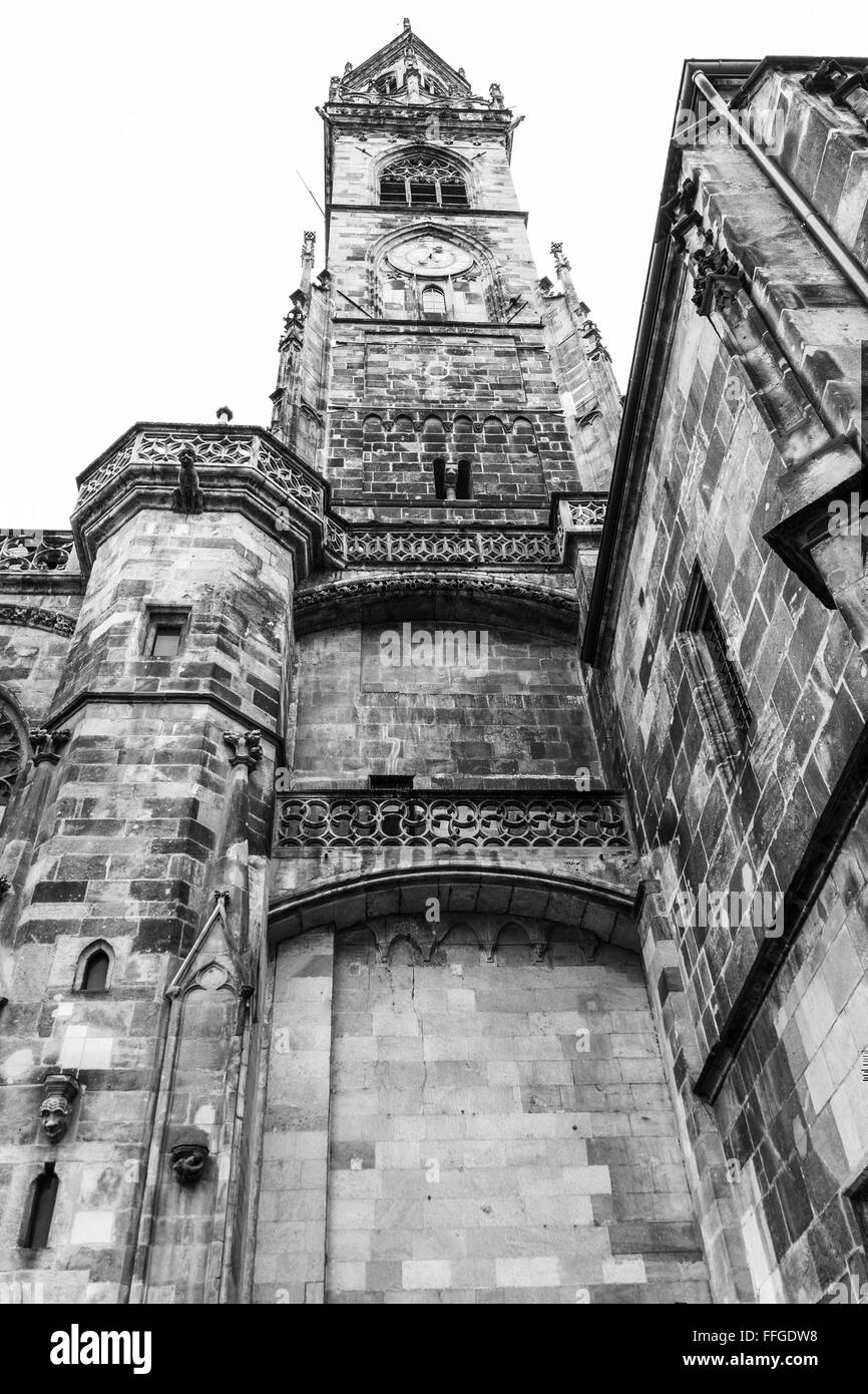 Bell tower of an ancient cathedral seen from below. - Stock Image