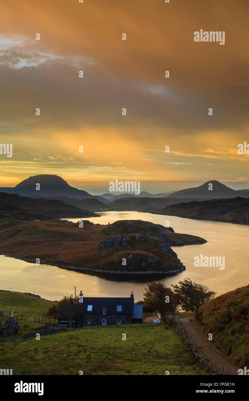 A vivid sunrise captured in late October, from above the north shore of Loch Inchard, near Kinlochbervie in North - Stock Image