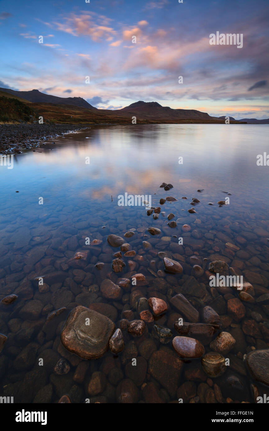 Loch Loyal in Northern Scotland captured at sunrise. - Stock Image