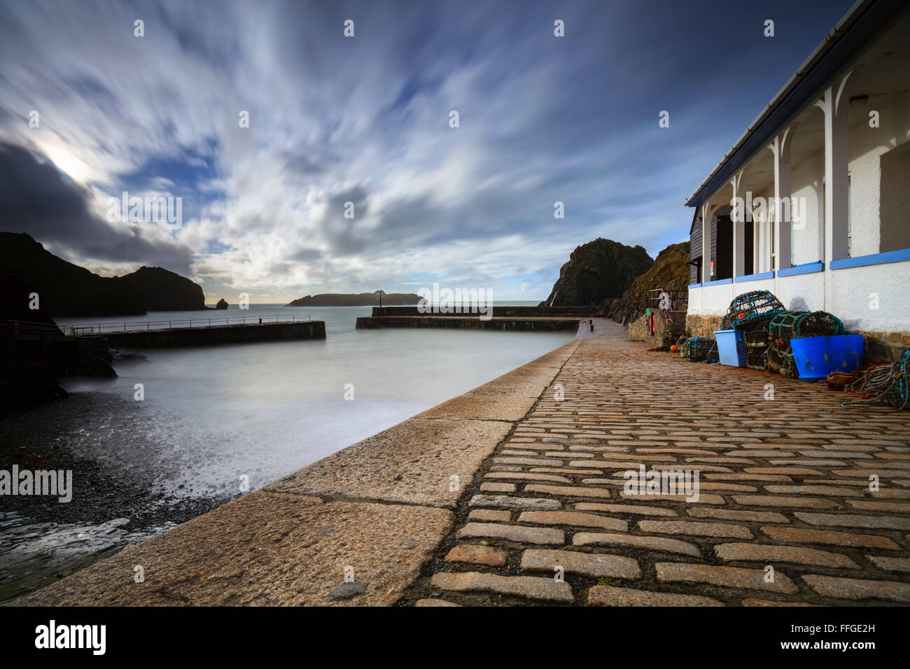 Mullion Harbour in Cornwall captured from the pier. - Stock Image