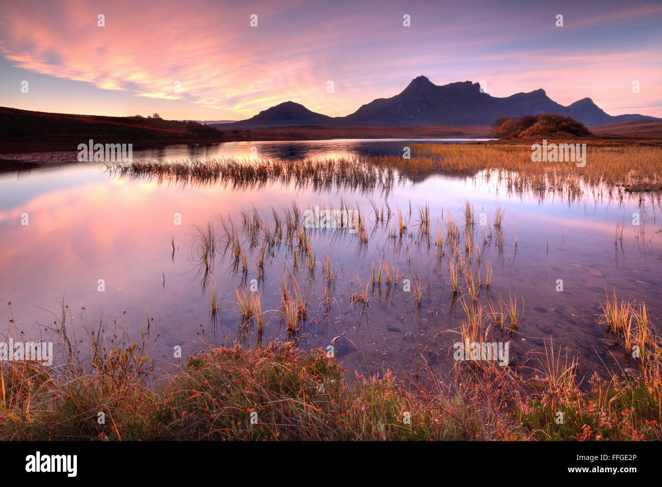 Sunrise over Ben Loyal, captured in early November  from the banks of Loch Hakel, near Tongue, in the North West - Stock Image