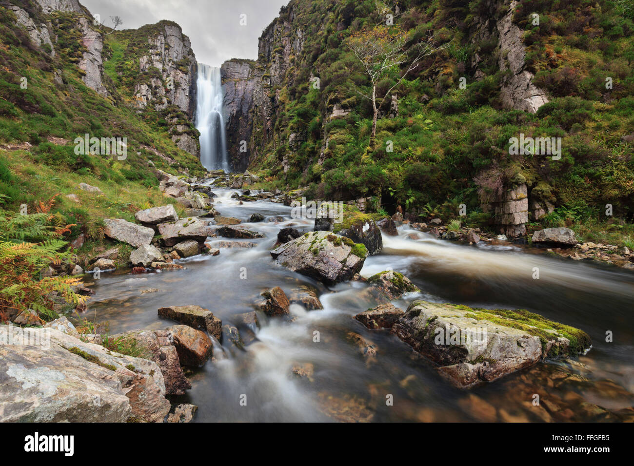 A waterfall hidden in a step sided valley on the northern side of  Loch na Gammhich in Assynt, North West Scotland. - Stock Image