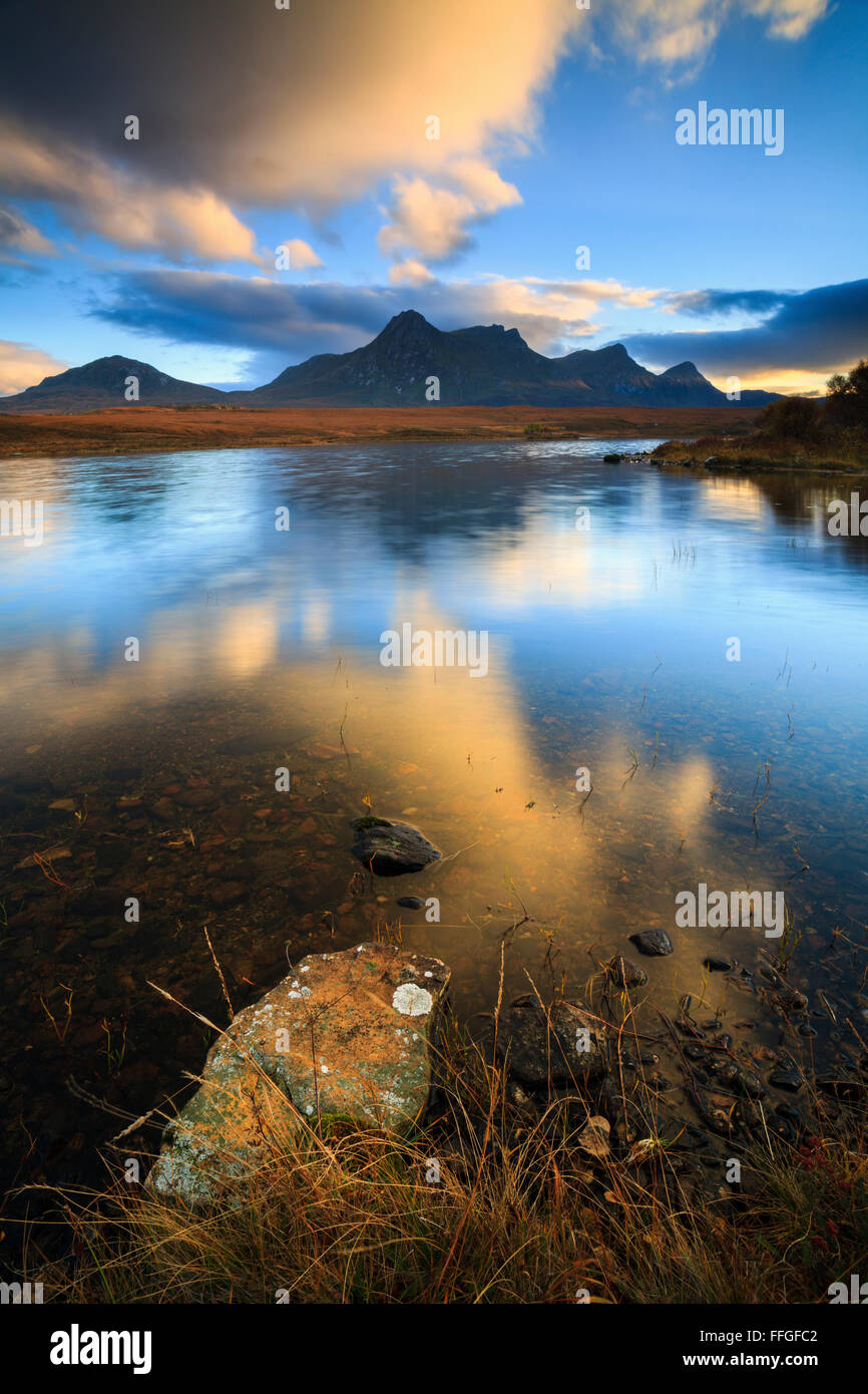Ben Loyal in the North West Highlands of Scotland, reflected in Loch Hakel at sunset in early November. - Stock Image