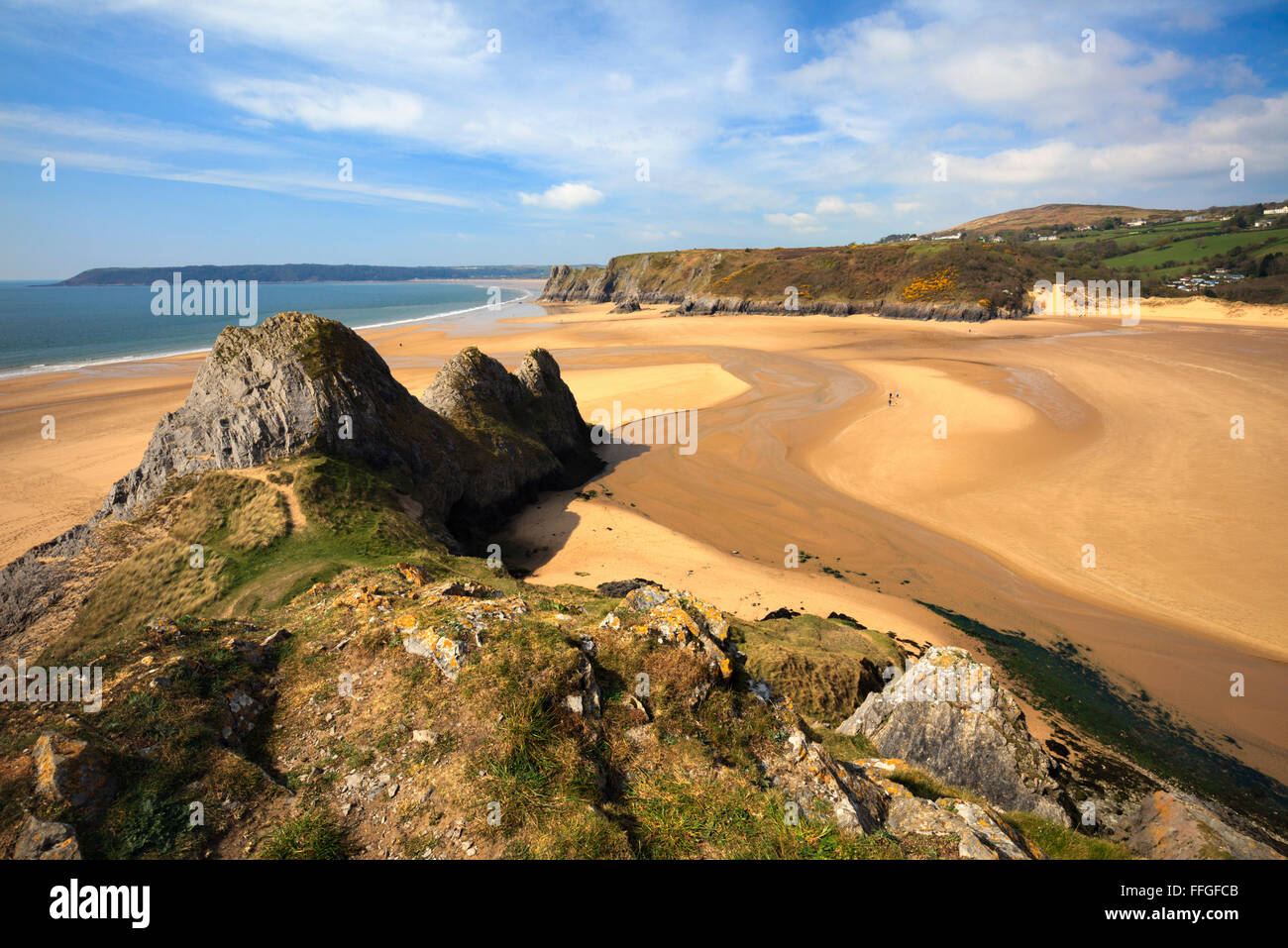 Three Cliffs Bay on the Gower Peninsular in South Wales captured from the cliffs to the East of the beach. Stock Photo
