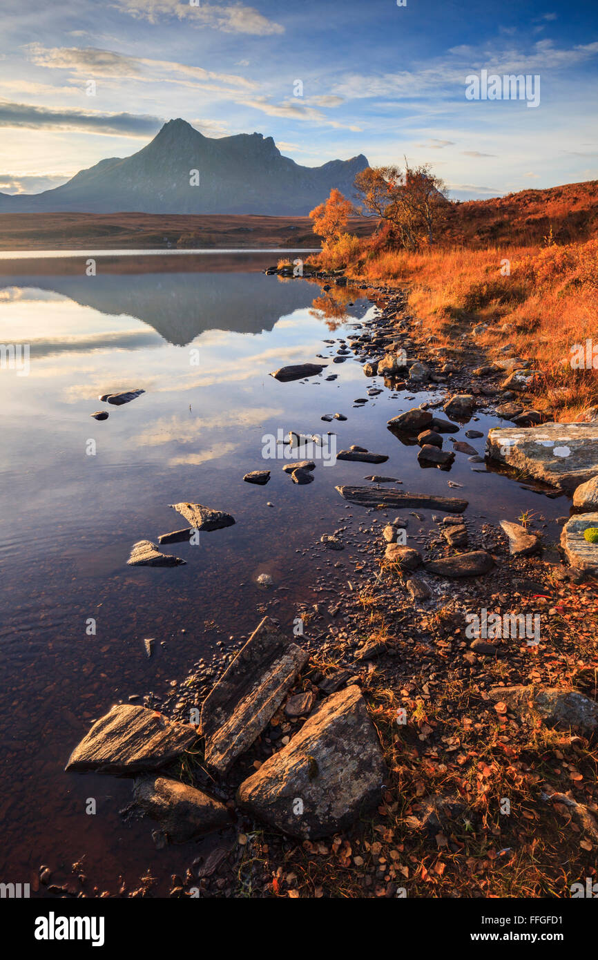 Ben Loyal captured shortly after sunrise in early November from the shore on the western side of Loch Hakel, near - Stock Image