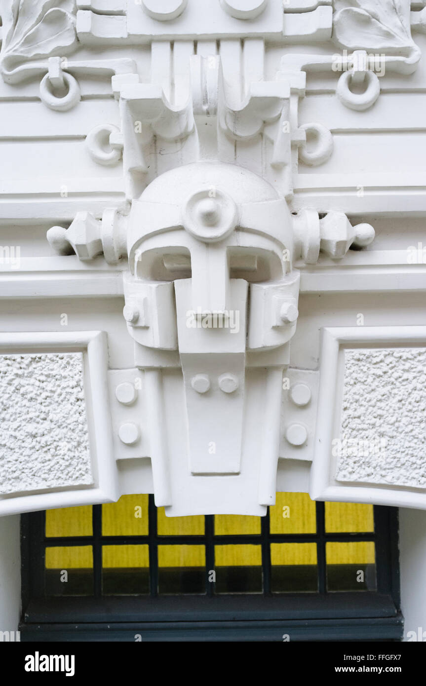 Detail of a Jugendstil building facade ornamental mask. Stockholm School of Economics, Strelnieku iela 4a, Riga, - Stock Image