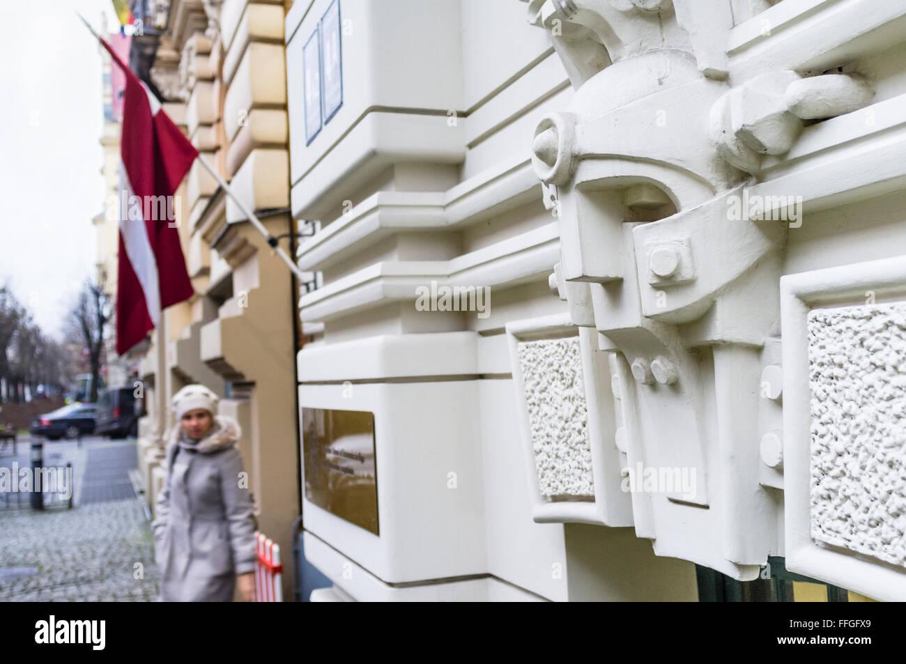 Jugendstil ornamental mask at the entrance of the  Stockholm School of Economics at Strelnieku iela 4a, Riga, Latvia - Stock Image