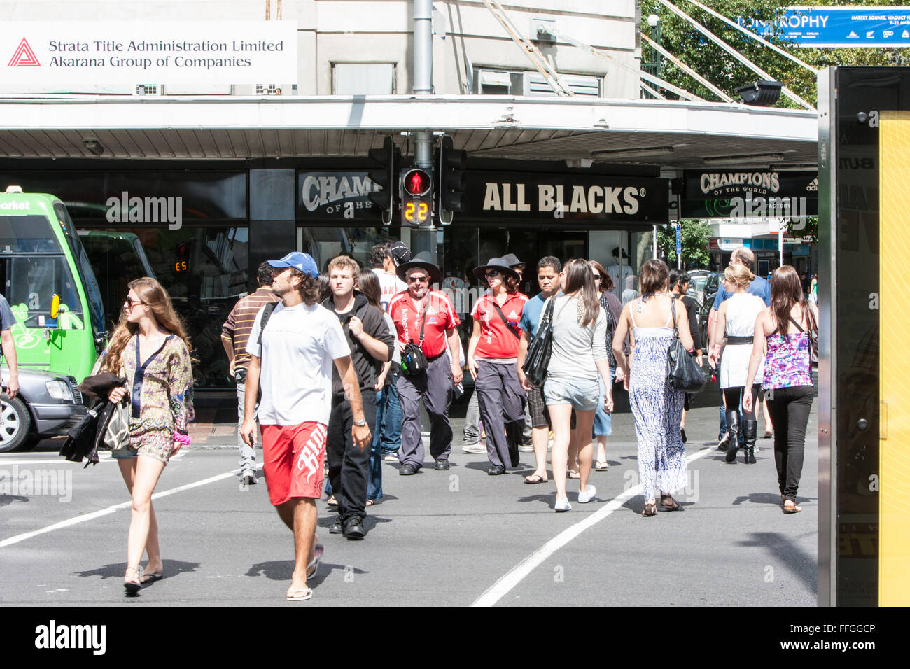 Locals and tourists crossing road,with countdown timing, at Queen Street,centre of Auckland,New Zealand - Stock Image