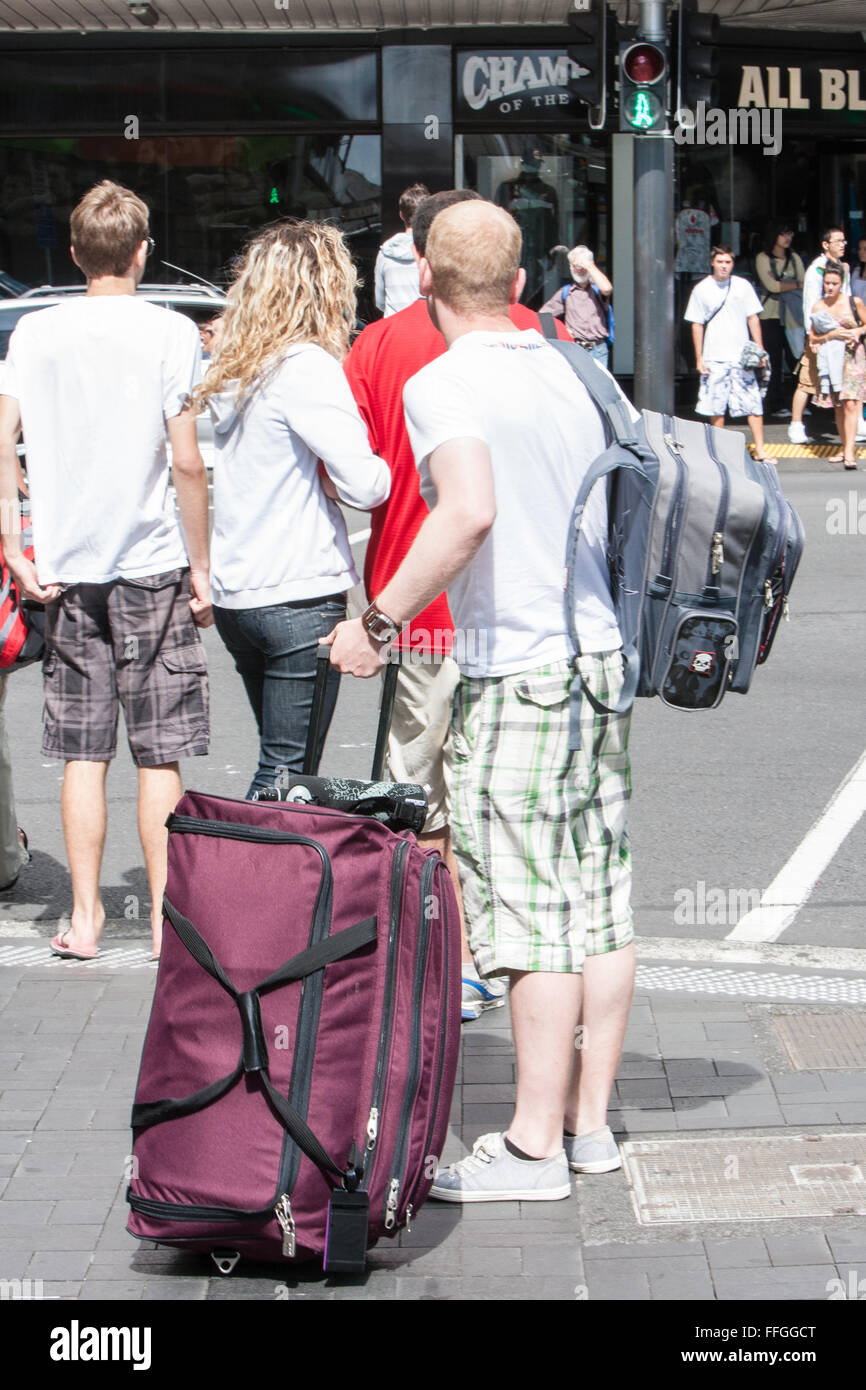 Tourist with luggage at crossing at Queen Street,centre,center of Auckland,New Zealand - Stock Image