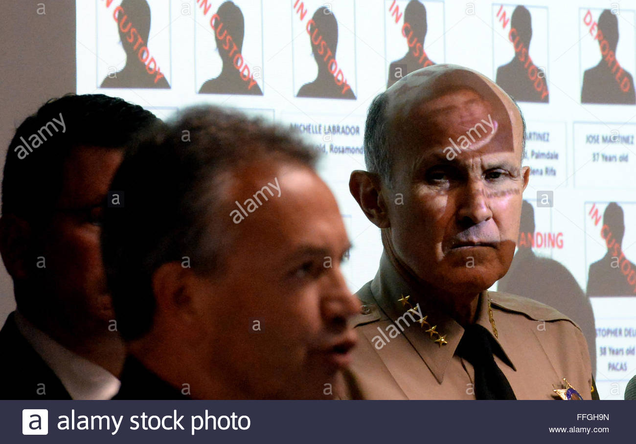 Pasadena, California, USA. 12th Dec, 2013. Los Angeles County Sheriff Department, Sheriff Lee Baca, right, listens - Stock Image