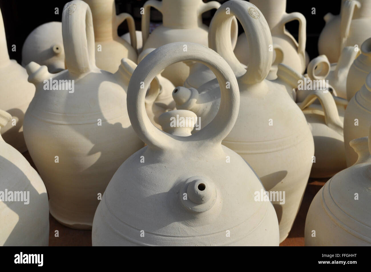 Traditional pottery for sale on a market stall, Spain. Stock Photo