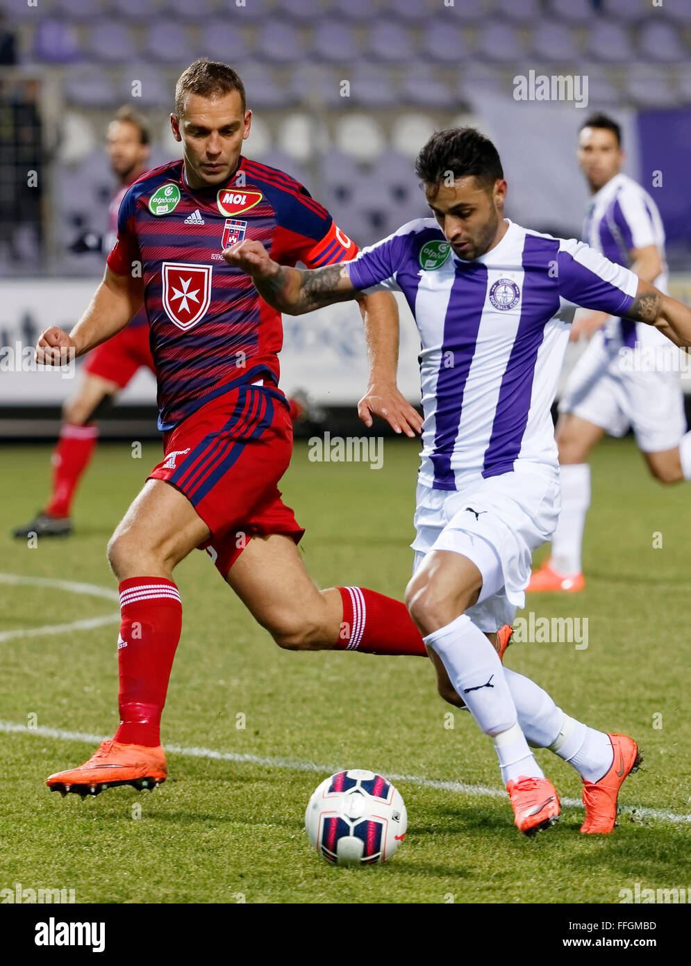 Budapest, Hungary. 13th Feb, 2016. Laszlo Lencse of Ujpest (r) is followed by Roland Juhasz of Videoton during Ujpest - Stock Image
