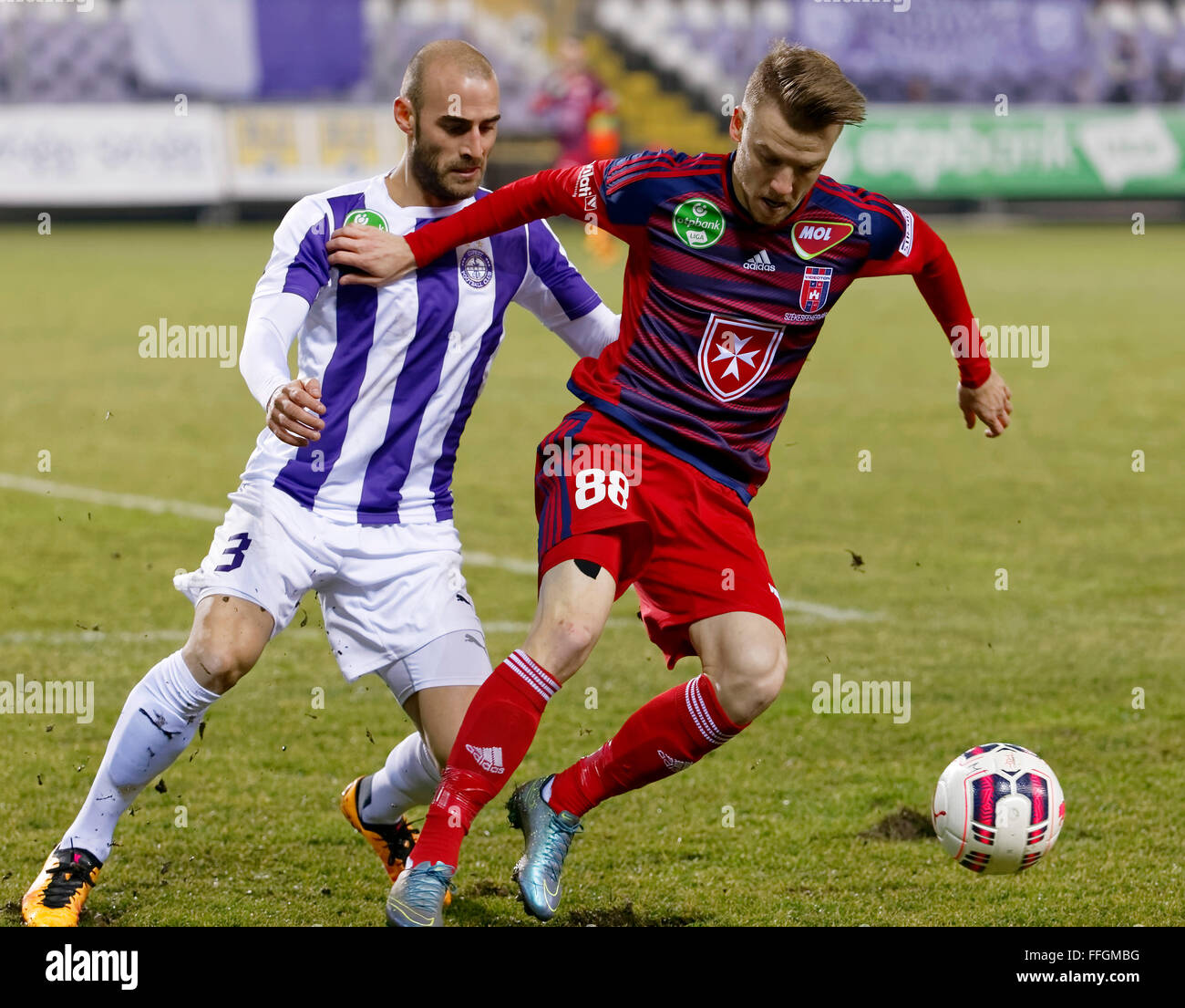 Budapest, Hungary. 13th Feb, 2016. Duel between Jonathan Heris of Ujpest (l) and Zsolt Haraszti of Videoton during - Stock Image