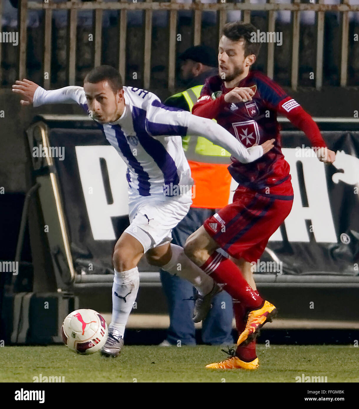 Budapest, Hungary. 13th Feb, 2016. Kylian Hazard of Ujpest (l) tries to overtake Asmir Suljic of Videoton during - Stock Image