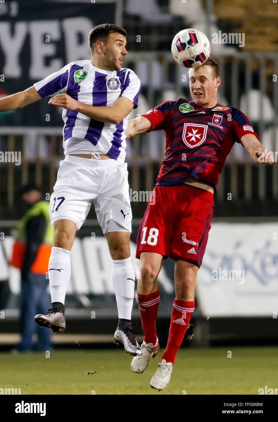 Budapest, Hungary. 13th Feb, 2016. Air battle between Viktor Angelov of Ujpest (l) and Adam Lang of Videoton during - Stock Image