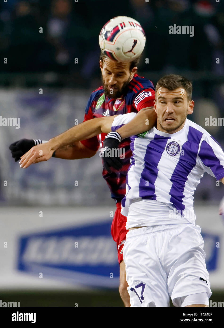Budapest, Hungary. 13th Feb, 2016. Air battle between Viktor Angelov of Ujpest (r) and Andras Fejes of Videoton - Stock Image