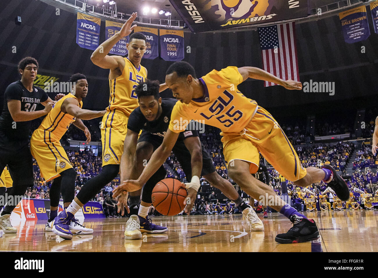 LSU Tigers Guard Tim Quarterman 55 Attempts To Steal The Ball From Texas AM Aggies Center Tonny Trocha Morelos 10 During An NCAA Basketball Game