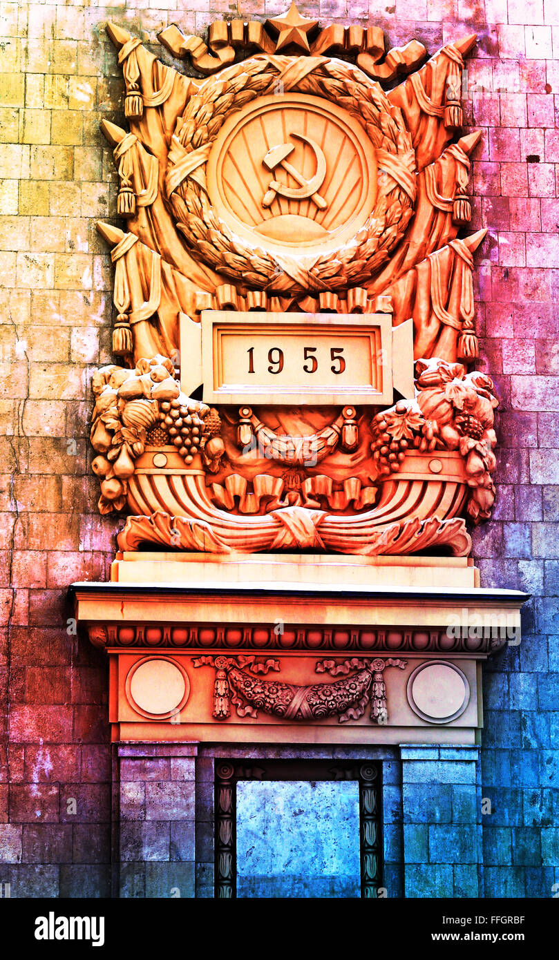 The Soviet Union emblem on the building photographed close up on colorful background - Stock Image