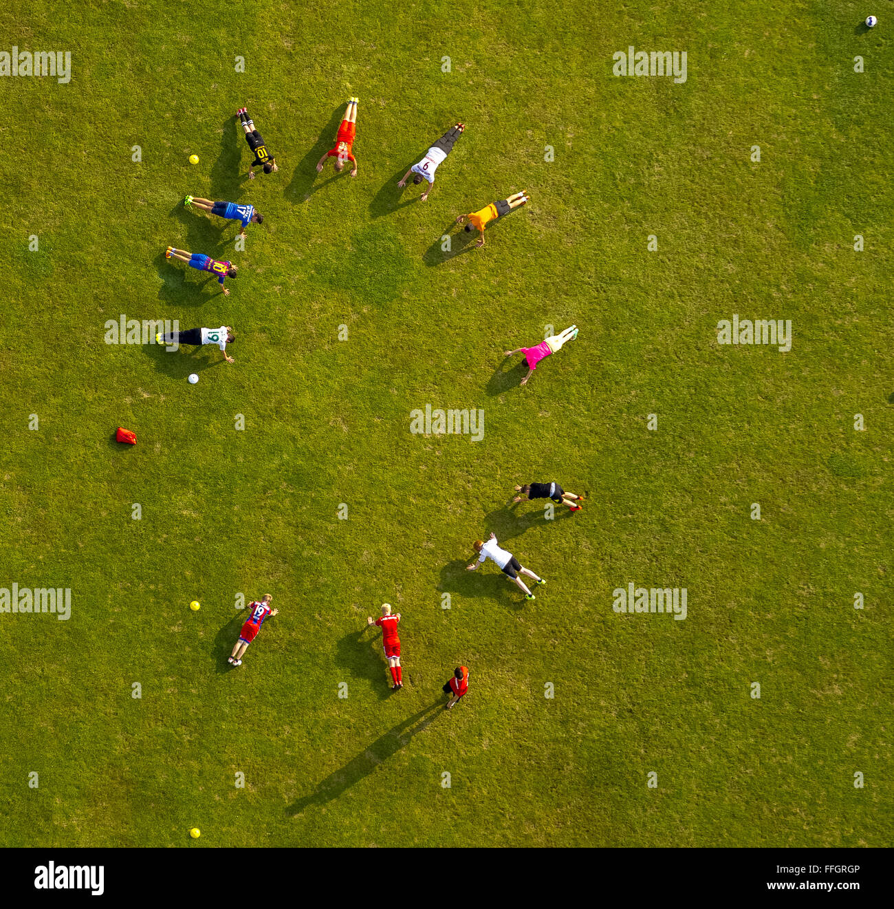 Aerial view, pushups, cardio, football team, aerial, training on the sports facility in the summer Kamp, Meschede, - Stock Image