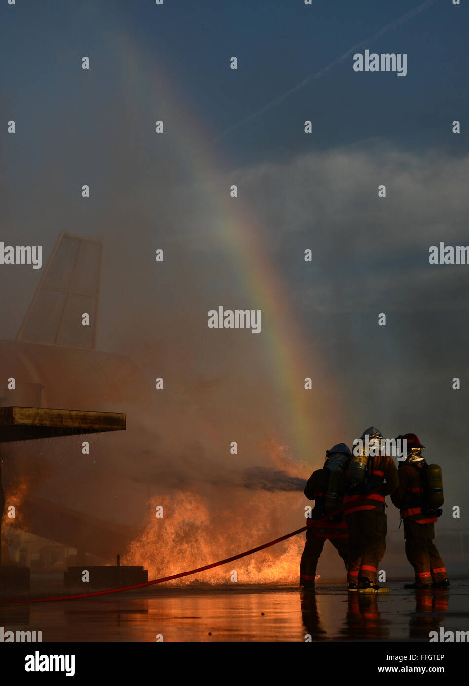 A rainbow appears as three Airmen assigned to the 312th Training Squadron, Goodfellow Air Force Base, Texas,  battle - Stock Image