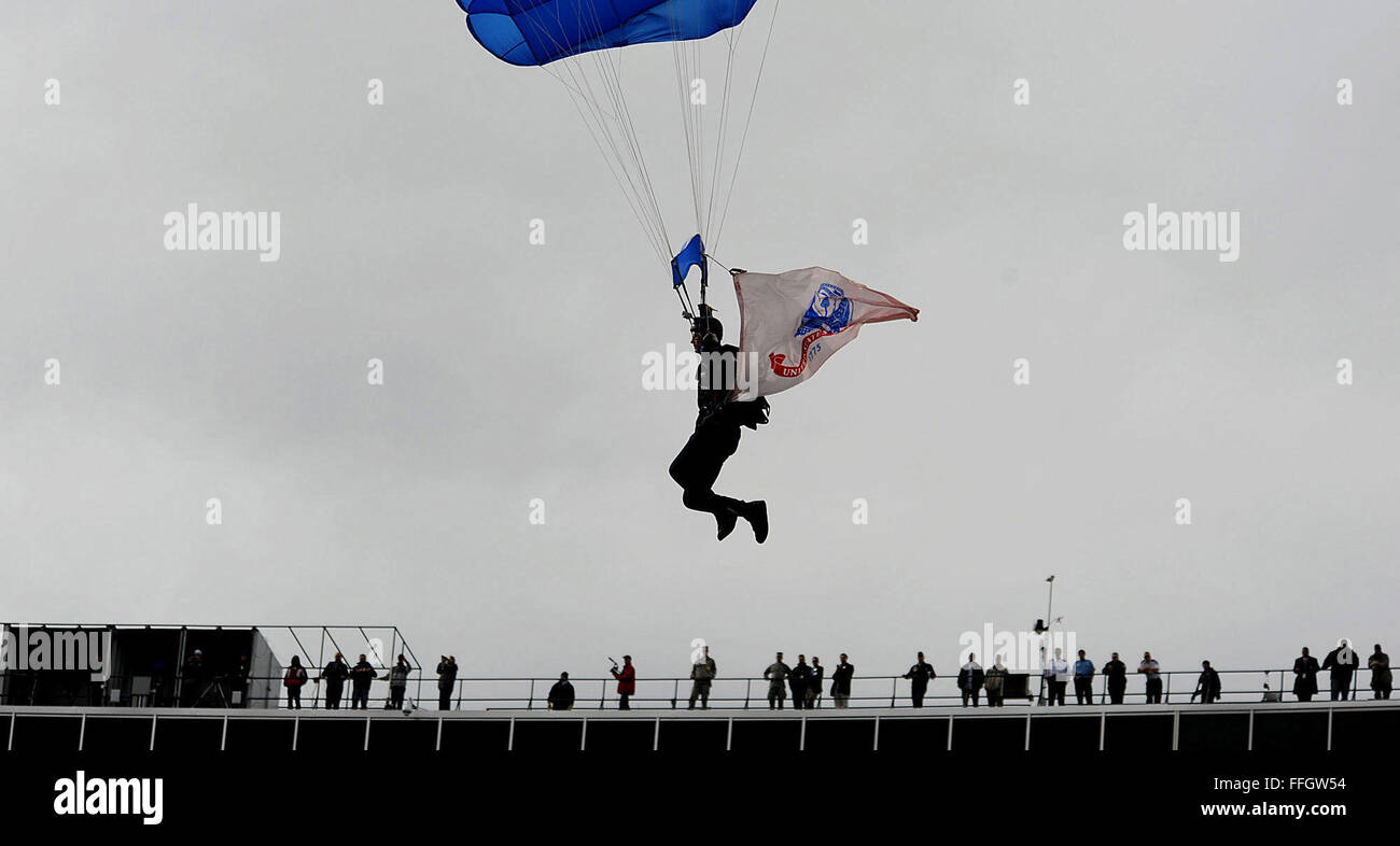 Parachuters glide into the stadium before the academy's football game against U.S. Military Academy at West - Stock Image