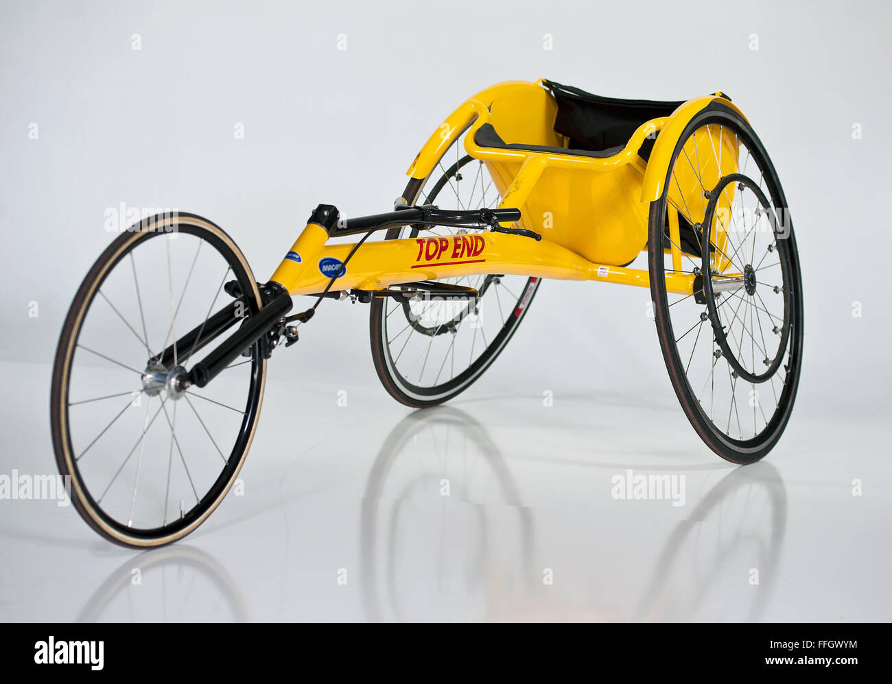 The handcycle is either arm-powered or arm-trunk powered. The rider can be in a kneeling position. The vehicle has - Stock Image
