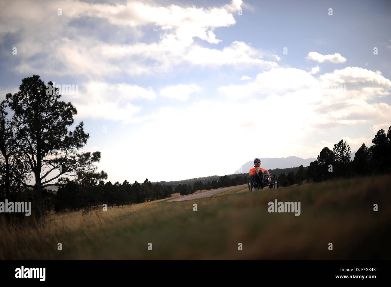 Capt. Anthony Simone practices for the cycling event during the Air Force team's Warrior Games selection camp - Stock Image