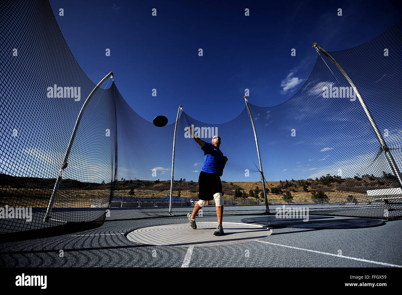 Retired Chief Master Sgt. Damian Orslene throws a discus during practice at the Air Force team's 2012 Warrior - Stock Image