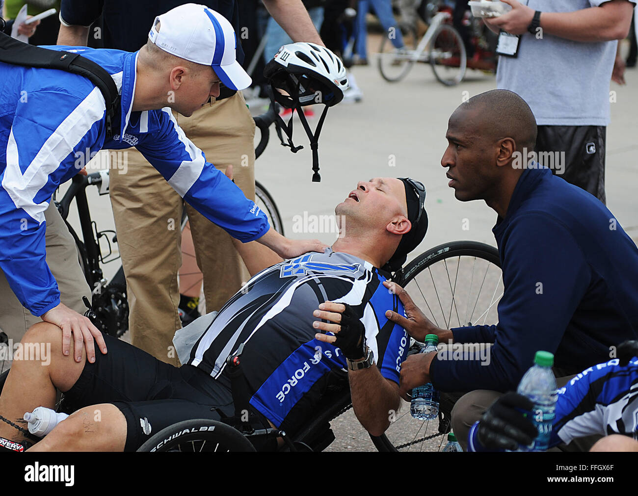Chief Master Sgt. Damian Orslene, center, catches his breath after taking part in the recumbent cycling event. - Stock Image