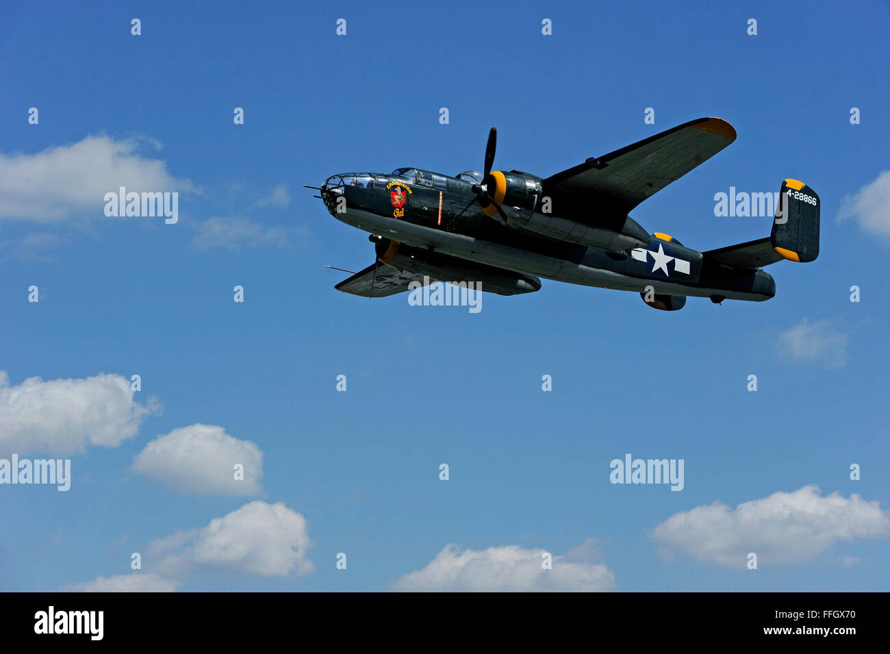 Champaign Aviation Museum's Champaign Gal B-25 Mitchell bomber flies over the Dayton, Ohio, area during a flyby - Stock Image