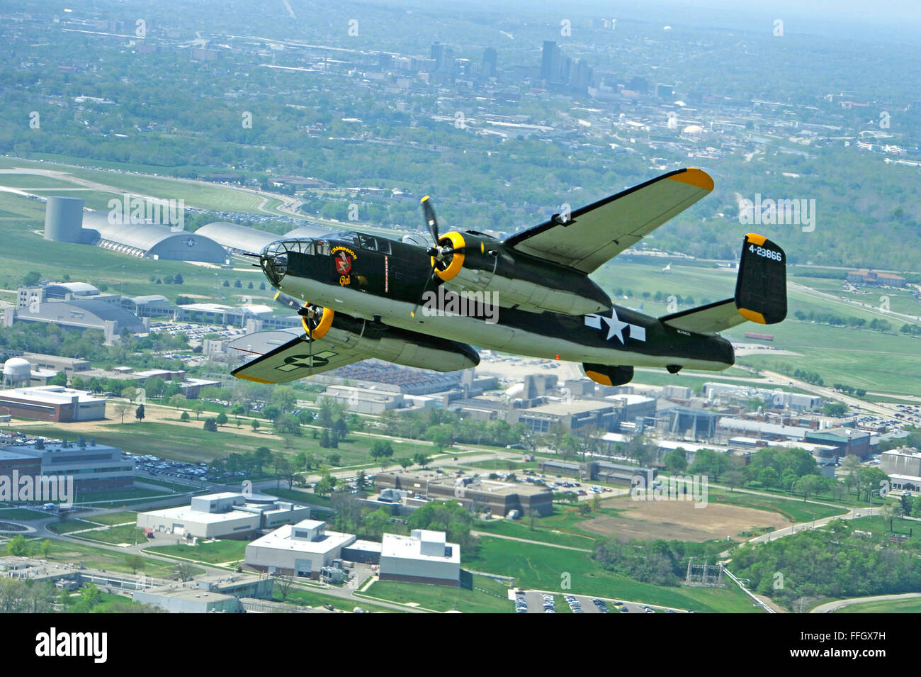 The Champaign Gal B-25 Mitchell bomber performs a flyby over the National Museum of the U.S. Air Force in honor - Stock Image