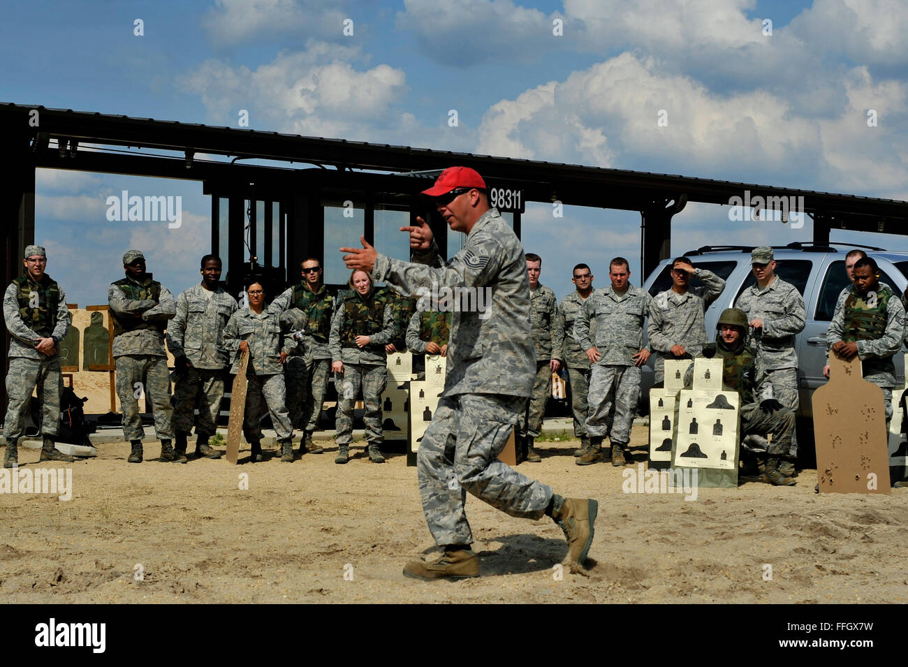 Tech. Sgt. Ricky Furrow demonstrates the new move and shoot portion of the Air Force Rifle Qualification Course. - Stock Image