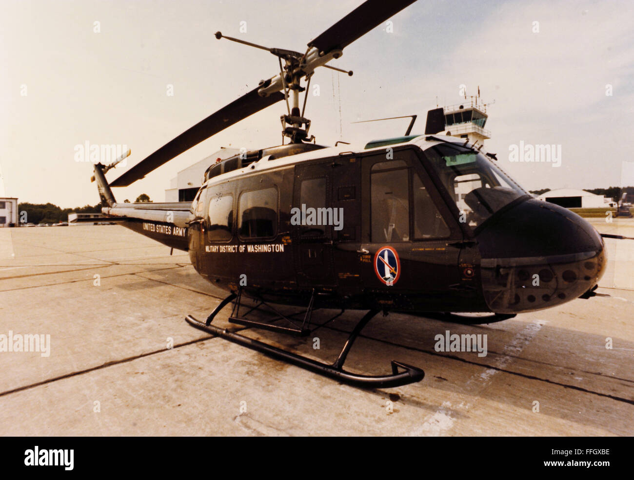 The command UH-1H of the Military District of Washington's 12th Aviation Battalion awaits takeoff in 1977. The - Stock Image