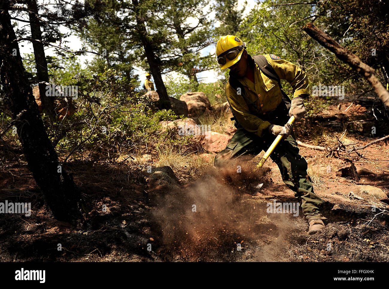 Lupe Covarrubias cuts a fire line in Colorado Springs, Colo. - Stock Image