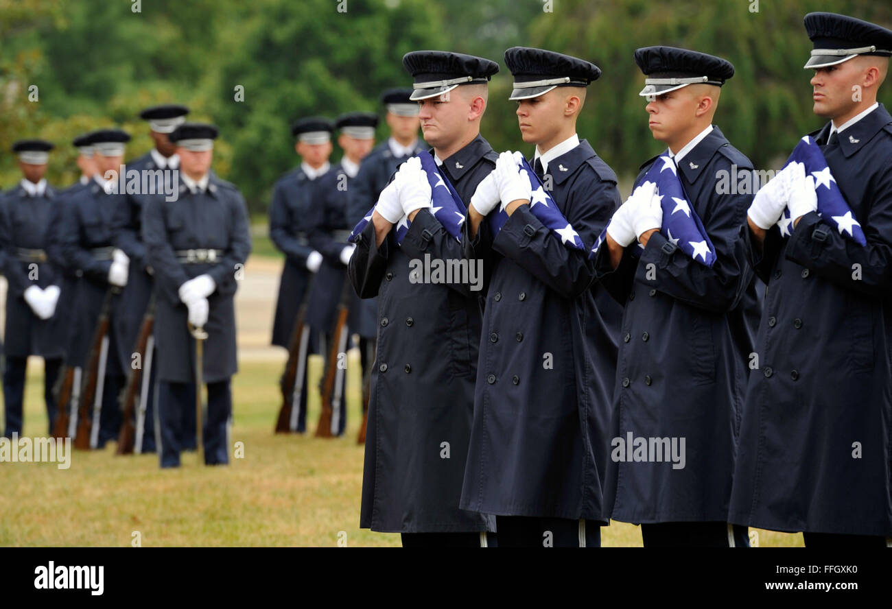 Members of the U.S. Air Force Honor Guard prepare to present folded flags to the families of six Airman who went - Stock Image