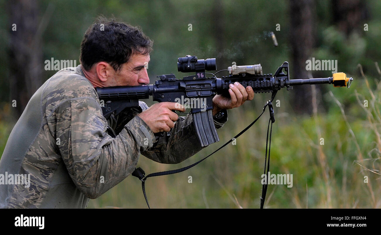 Maj. Christopher Wright fires his M4 carbine during a combat mission readiness evaluation at Fort Bragg, N.C. - Stock Image