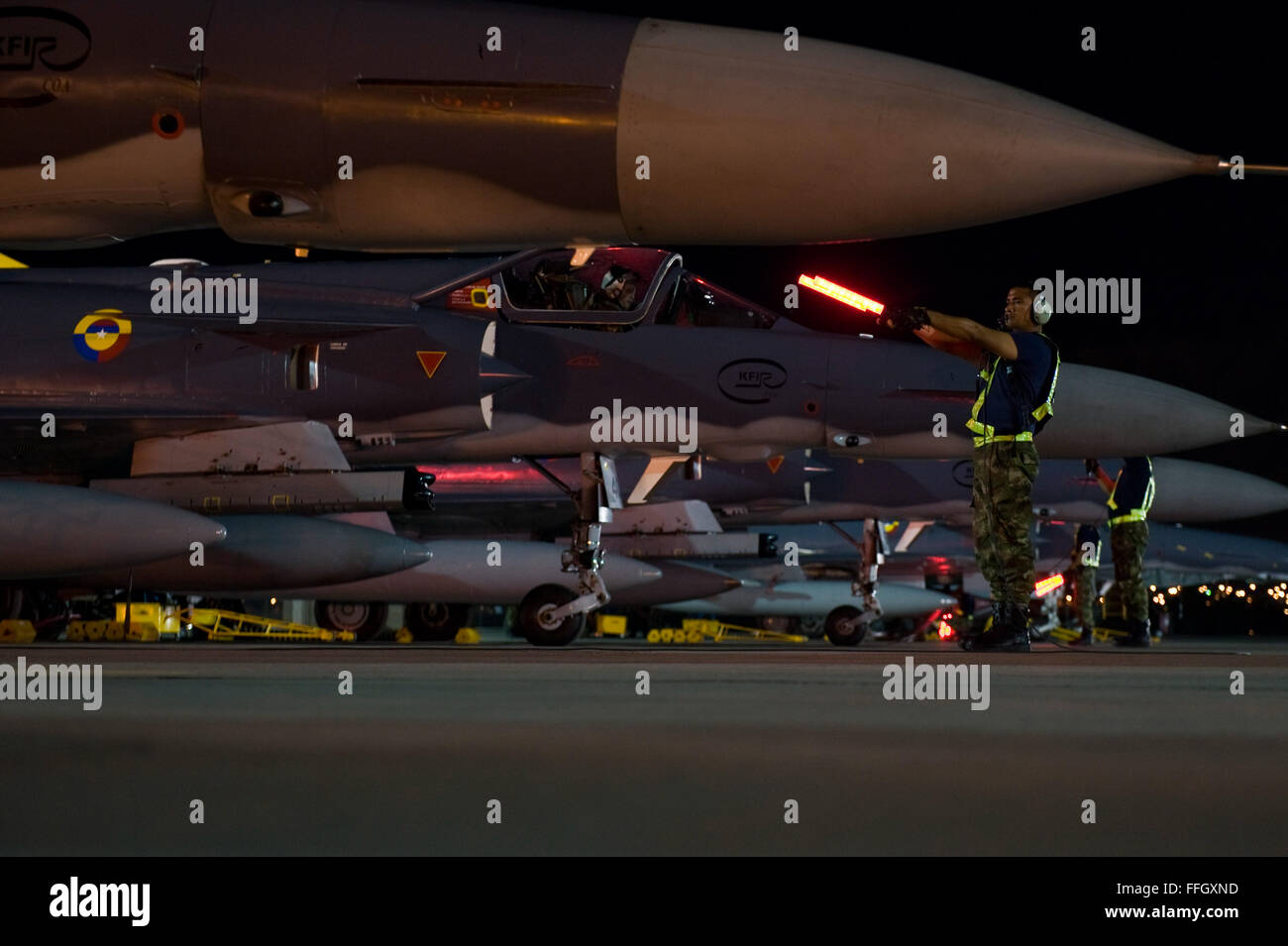 Colombian air force crew chiefs marshal out Colombian F-21 Kfirs onto the flightline during Red Flag 12-4 at Nellis - Stock Image