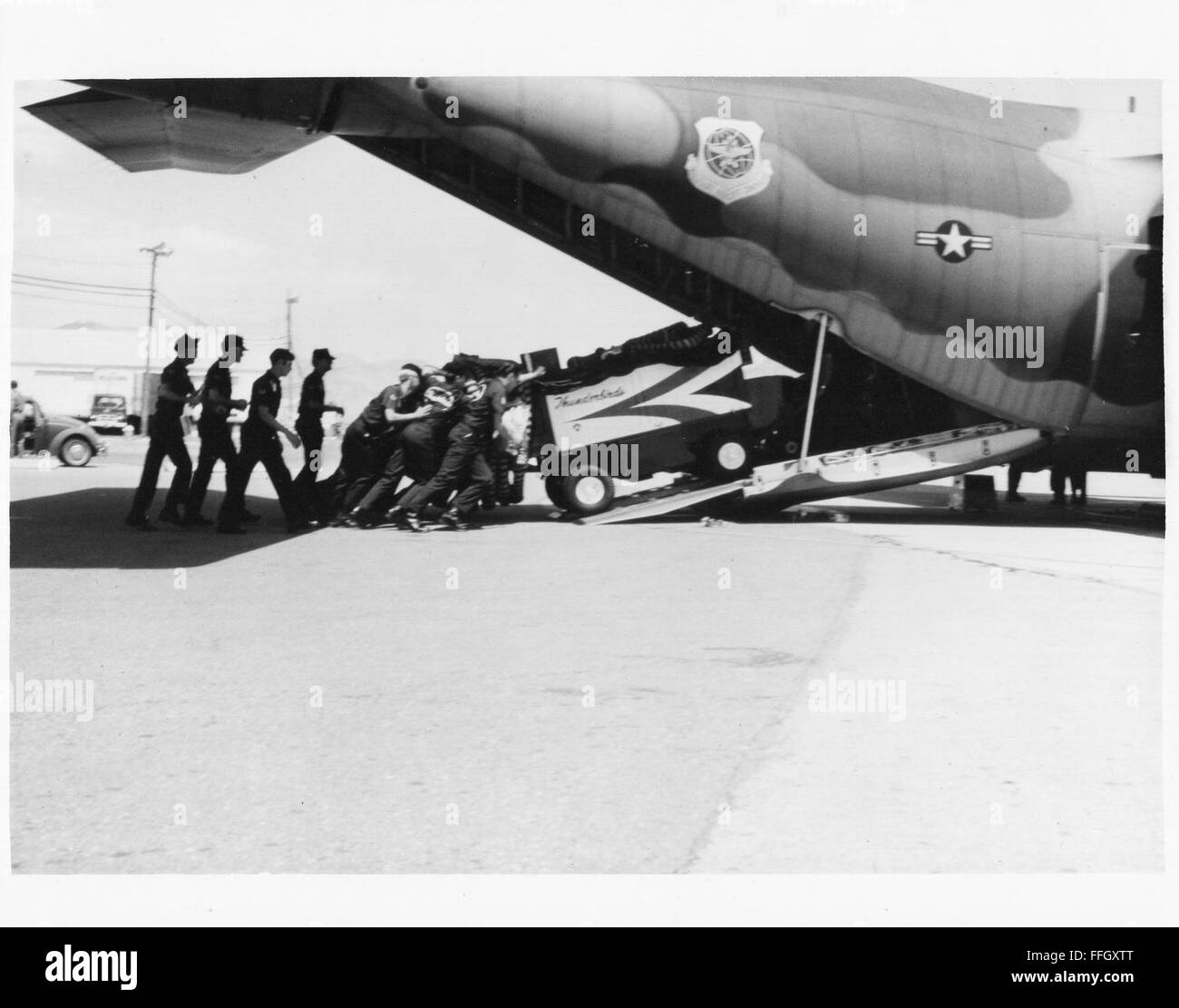 Thunderbirds upload equipment on a C-123 Provider. Various job specialties contribute to uploading and downloading - Stock Image